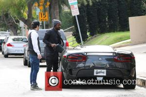 will.i.am and William Adams - will.i.am arrives at Justin Bieber's office in Beverly Hills in a custom car by West...