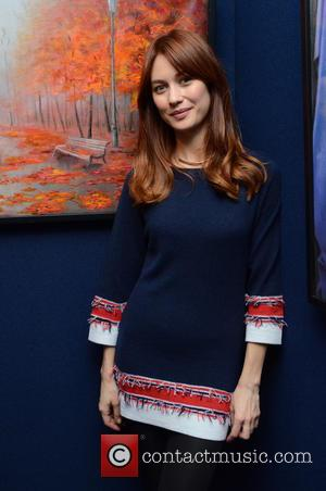 Olga Kurylenko - Olga Kurylenko attends her mother's art exhibition, the Marina Alyabusheva Exhibition, at MacDougall's in London to celebrate...