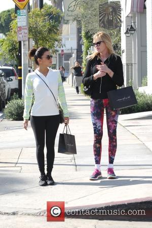Melanie Griffith and Eva Longoria - Eva Longoria and Melanie Griffith have lunch together at Grasias Mardre on Melrsose -...