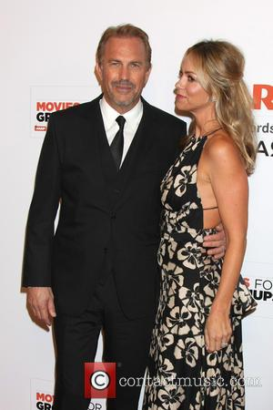 Kevin Costner and Christine Baumgartner - AARP Movies for Grownups Awards Gala at Beverly Wilshire Hotel - Los Angeles, California,...