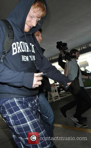 British singer songwriter Ed Sheeran was spotted wearing pyjama bottoms as he arrived in to Los Angeles International Airport in...