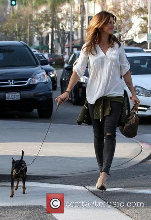 elizabetta canalis - Elisabetta Canalis walking her pet dog in high heels after having lunch with a pal gal at...