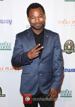 Shane Mosley - Photographs of a variety of stars as they arrived at the Whole Planet Grammy Pre-Party which was...