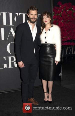Jamie Dornan and Dakota Johnson - Shots from a fan screening of the new erotic movie 'Fifty Shades of Grey'...
