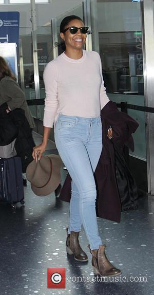 Gabrielle Union - Gabrielle Union is all smiles as she arrives at Los Angeles International Airport (LAX) - Los Angeles,...