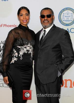 Gina Torres and Laurence Fishburne