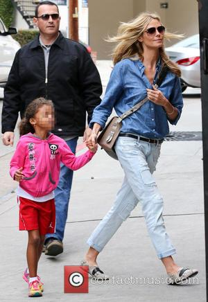 Heidi Klum and Lou Samuel - Heidi Klum and Seal watch their kids play soccer in Brentwood at soccer field...