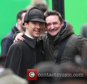 Benedict Cumberbatch - Benedict Cumberbatch and Martin Freeman film a scene for the 'Sherlock' christmas special in London - London,...