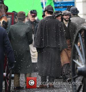 Martin Freeman and Benedict Cumberbatch - Benedict Cumberbatch and Martin Freeman film a scene for the 'Sherlock' christmas special in...