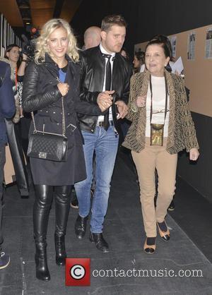 Michael Buble and Luisana Lopilato - Mercedes-Benz Madrid Fashion Week Fall/Winter 2015 - Davidelfin - Arrivals - Madrid, Spain -...
