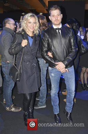 Michael Buble and Luisana Lopilato - Mercedes-Benz Madrid Fashion Week Fall/Winter 2015 - Davidelfin - Arrivals - Madrid, Spain -...