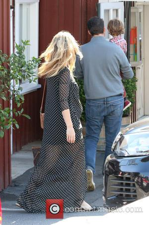 Molly Sims - Heavily pregnant Molly Sims wearing a navy blue polka dot maxi dress out and about in Brentwood...