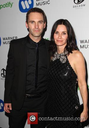 Courteney Cox And Johnny Mcdaid Seal Reunion With A Kiss