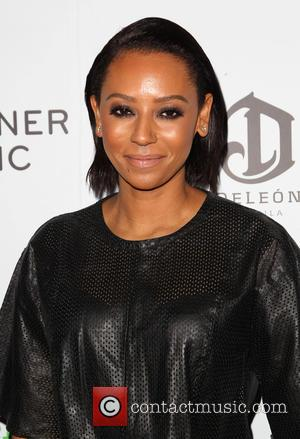Melanie Brown - A variety of stars were photographed as they arrived to the Warner Music Group post Grammy Party...