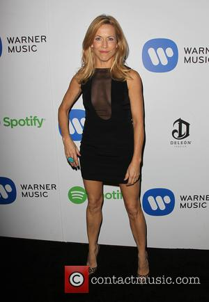 Sheryl Crow - A variety of stars were photographed as they arrived to the Warner Music Group post Grammy Party...