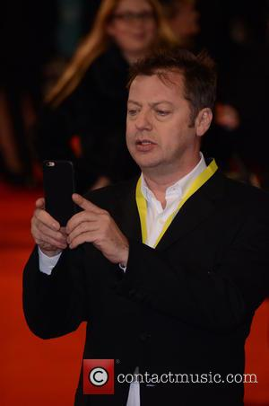 Matthew Freud trying t get a picture of his daughter near Benedict Cumberbatch on the BAFTAS red carpet - Various...