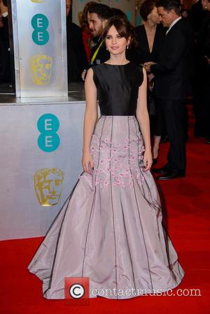 Felicity Jones - Various stars of film and television were photographed on the red carpet as they arrived for the...