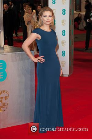 Myanna Buring - EE British Academy Film Awards (BAFTA) at The Royal Opera House - Red Carpet Arrivals at Covent...