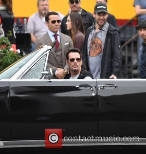 Kevin Dillon and Adrian Grenier - The 'Entourage' cast film an ending scene in Los Angeles for their movie which...