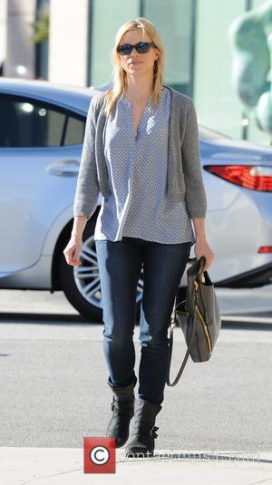 Amy Smart dressed in a crescent patterned top covered with a small grey cardigan out running errands in Beverly Hills...