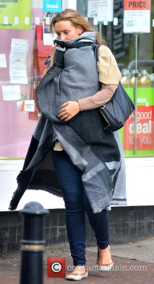 Catherine Tyldesley - Pregnant Catherine Tyldesley hides her baby bump whilst out and about in Manchester - Manchester, United Kingdom...