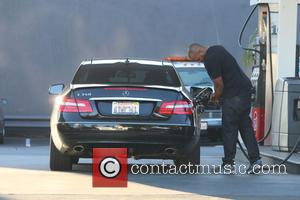 Donald Faison - Scrubs actor Donald Faison pumping gas in his Mercedes in West Hollywood at 76 Gas Station -...