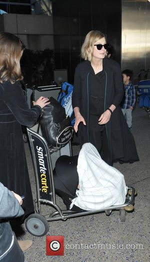 Rosamund Pike - Rosamund Pike arrives at Los Angeles International Airport (LAX) using a novel way of using an airport...