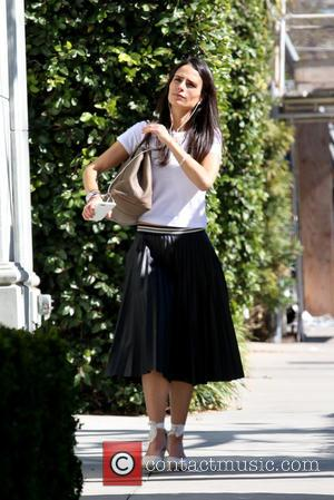 Brazilian-American actress Jordana Brewster who recently starred in 'Furious 7' was spotted out wearing a black pleated shirt and white...