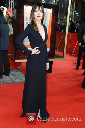 Dakota Johnson - Stars from the upcoming raunchy movie 'Fifty Shades of Grey' were photographed on the red carpet at...