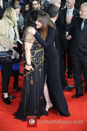 E. L. James and Dakota Johnson