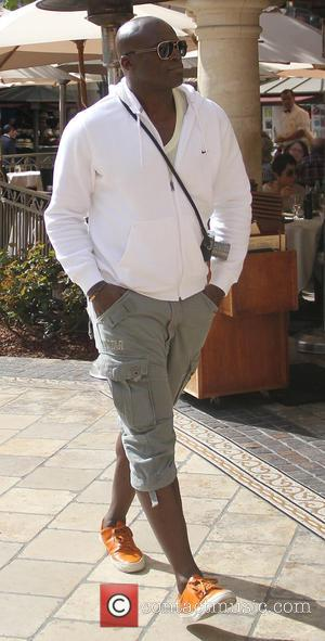 Seal - Singer, Seal goes shopping at The Grove in Hollywood carrying a compact vintage camera around his neck -...