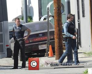 Colin Farrell and Taylor Kitsch - Actor Colin Farrell draws his gun in an action scene for 'True Detectives' with...