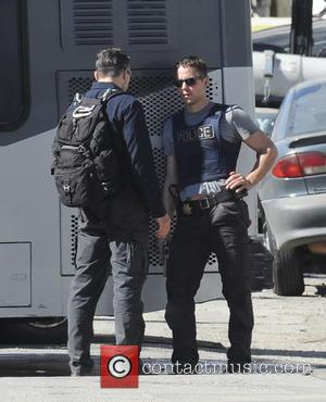 Taylor Kitsch - Actor Colin Farrell draws his gun in an action scene for 'True Detectives' with co-star Taylor Kitsch...