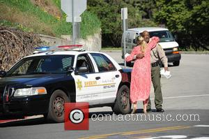 Molly Sims - Pregnant Molly Sims seems pleased with the outcome of a traffic stop giving the deputy a hug...