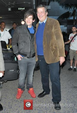 Stephen Fry and Elliot Spencer - Stephen Fry and husband Elliot Spencer arrive at Los Angeles International Airport (LAX) at...