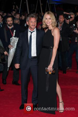 Sean Penn And Girlfriend Charlize Theron Look Loved Up At 'The Gunman's' UK Premiere [Pictures]