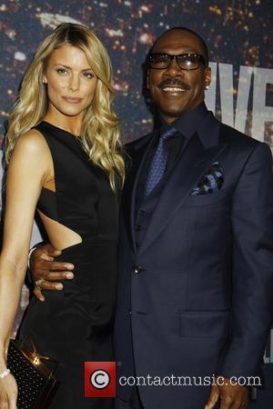 Eddie Murphy and girlfriend - Saturday Night Live 40th Anniversary - Arrivals at Saturday Night Live - New York, New...