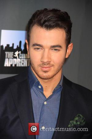 Kevin Jonas - The Celebrity Apprentice Finale Red Carpet at Trump Tower in New York City at Trump Tower -...