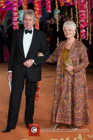 Dame Judi Dench and David Mills - A host of stars were photographed as they attended the UK premiere of...