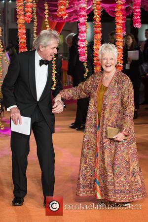 Dame Judi Dench and Guest - A host of stars were photographed as they attended the UK premiere of 'The...