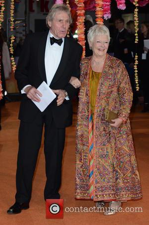 Dame Judi Dench and partner - A host of stars were photographed as they attended the UK premiere of 'The...