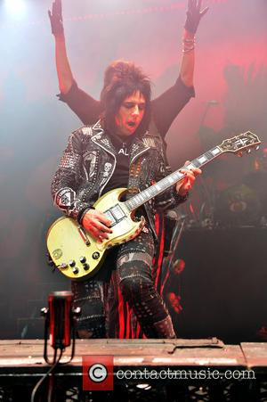 Alice Cooper and Tommy Henriksen - Shots of rock legend Alice Cooper as he performed live on stage at Hard...