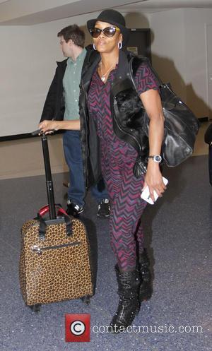 Vivica A. Fox - Vivica A. Fox arrives at Los Angeles International Airport (LAX) - Los Angeles, California, United States...