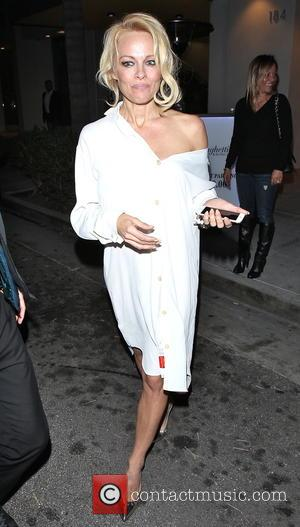 Pamela Anderson - Pamela Anderson is all smiles as she leaves Spaghettini restaurant in Beverly Hills after having dinner. -...