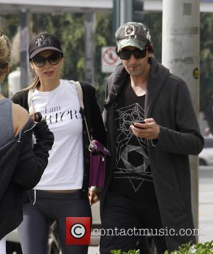 Adrien Brody and Lara Lieto - Adrien Brody and Lara Lieto can't keep their hands off each other at Earthbar...