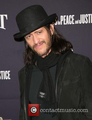 Clifton Collins and Jr. - A variety of stars were snapped as they attended the 8th annual pre-Oscar Hollywood Domino...