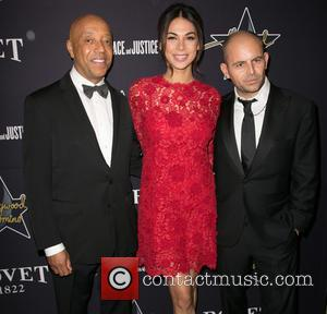Russell Simmons, Moran Attis and David Belle - A variety of stars were snapped as they attended the 8th annual...