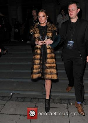 Lindsay Lohan - London Fashion Week Autumn Winter 2015 - Gareth Pugh - Departues at London Fashion Week - London,...