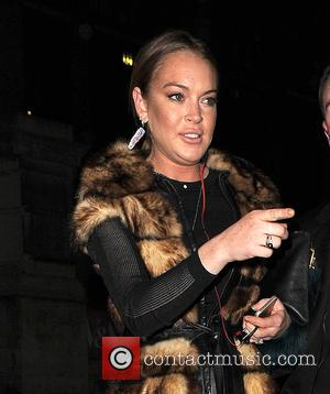 Lindsay Lohan - London Fashion Week Autumn/Winter 2015 - Gareth Pugh - Departures at London Fashion Week - London, United...