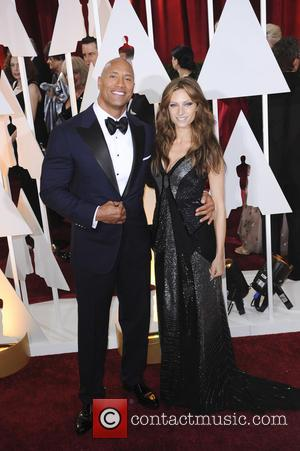Dwayne Johnson , Lauren Hashian - The 87th Annual Oscars held at Dolby Theatre - Red Carpet Arrivals at Oscars,...